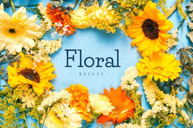 Concept de maquette avec cadre floral circulaire