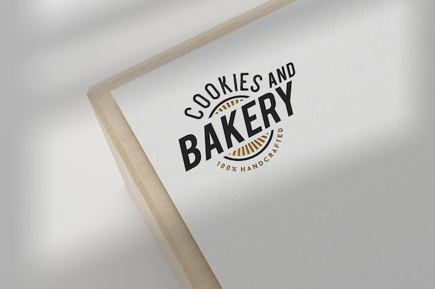 Conception de maquette de logo de boulangerie sur papier blanc
