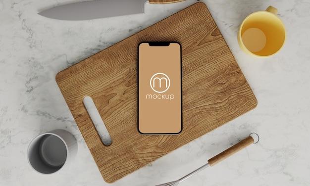 Conception moderne de maquette de téléphone de cuisine sur marbre