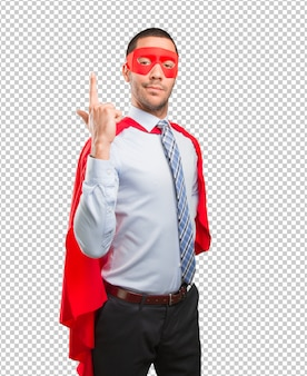 Confiant super homme d'affaires pointant