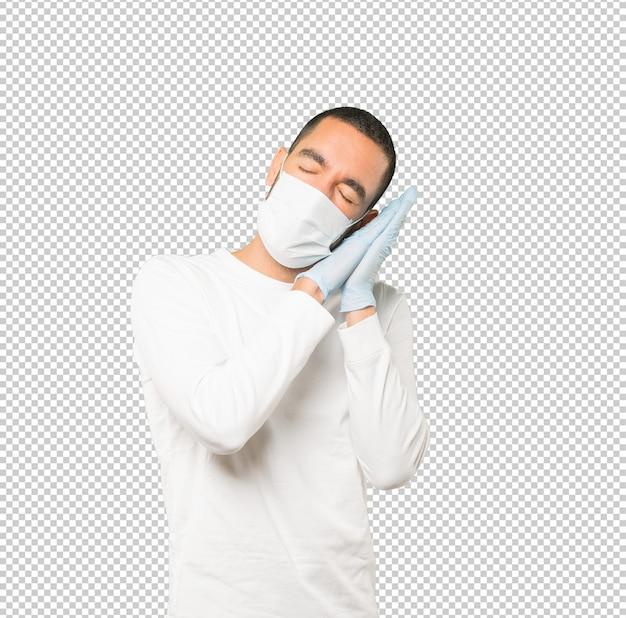 Coronavirus.jeune homme faisant des concepts et portant un masque et des gants de protection
