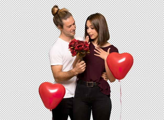 Couple en saint valentin avec des fleurs
