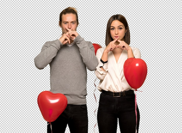 Couple en saint valentin montrant un geste du silence