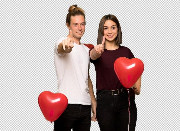 Couple, saint valentin, montrer, lever doigt