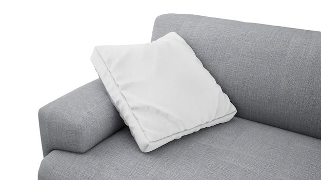 Coussin sur canapé gris isolé