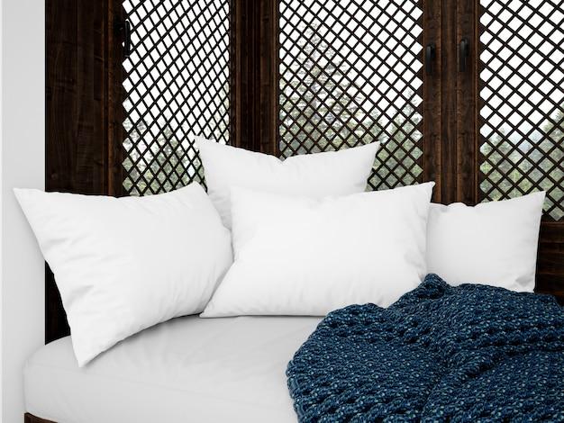 Coussins blancs réalistes sur un canapé rustique
