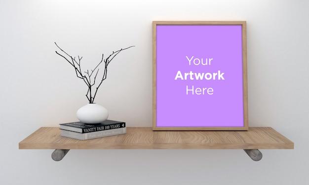 Décor de cadres photo vide avec vase et livres