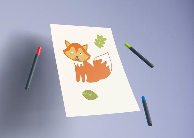 Dessin de renard artistique avec des marqueurs à côté