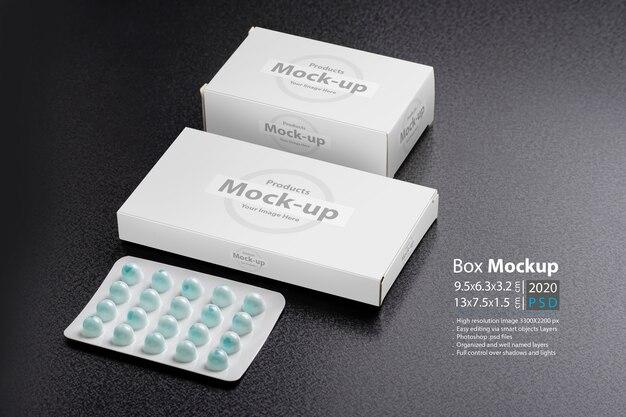 Deux boîtes à pilules avec un pain sur une surface sombre