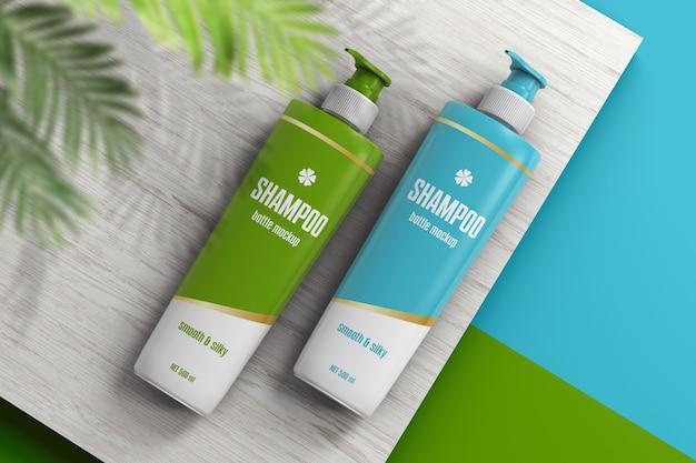 Deux bouteilles de shampoing sur maquette de surface en bois