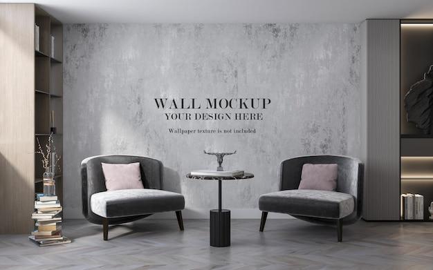 Deux fauteuils en velours gris devant le mur de la maquette