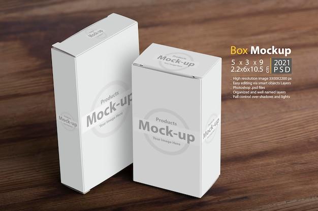 Deux paquets de piluliers sur fond de table en bois modèle de maquette modifiable prêt pour votre conception