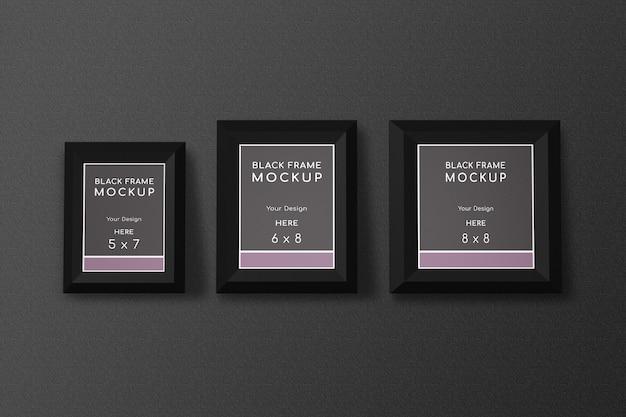 Diverses maquettes de cadres noirs sur mur noir