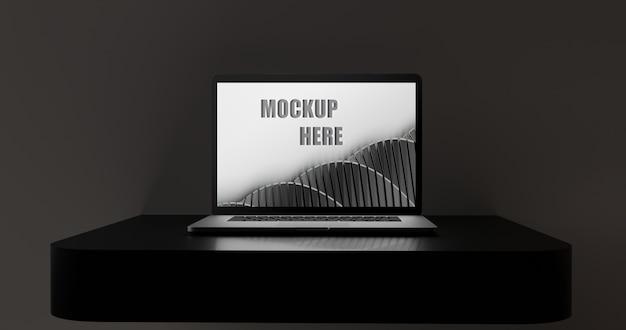 Écran de maquette d'ordinateur portable sur un bureau noir brillant