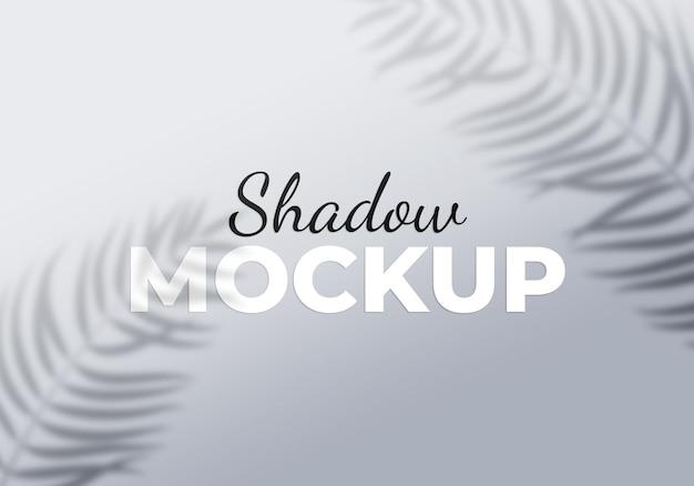 Effet de superposition grise d'ombres transparentes avec des feuilles de palmier