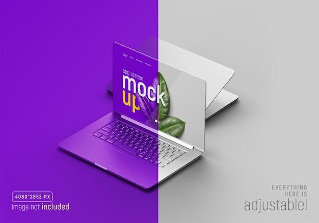 Ensemble de deux vues en perspective de maquette de macbook pro argent réaliste
