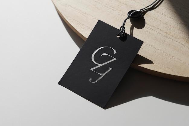 Étiquette noire de maquette de logo