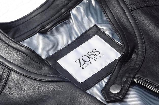 Étiquette de veste en cuir noir de luxe de maquette de logo