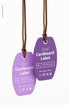 Étiquettes ovales en carton avec maquette de corde en cuir, suspendues