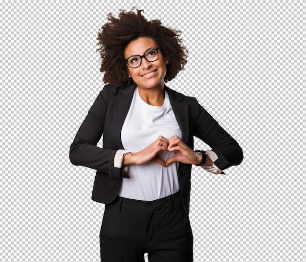 Femme noire d'affaires faisant le symbole du coeur