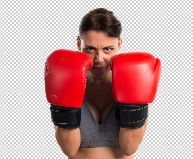 Femme de sport avec des gants de boxe