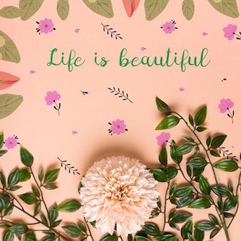 Feuilles réalistes et fleur sur papier