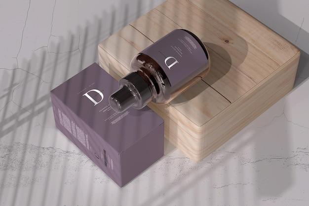 Flacon compte-gouttes en verre ambré avec maquette de boîte