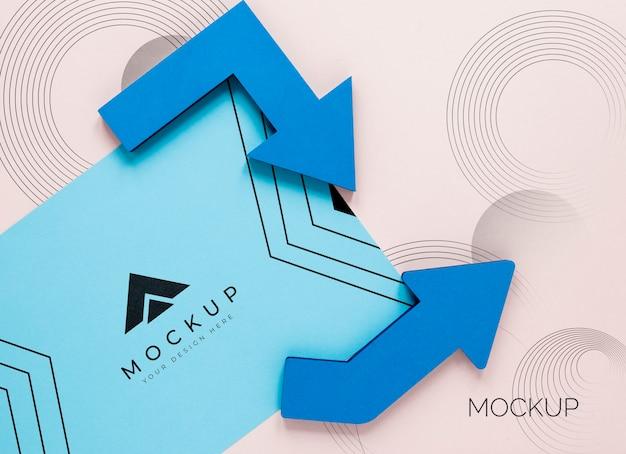 Flèches bleues et carte de maquette d'entreprise