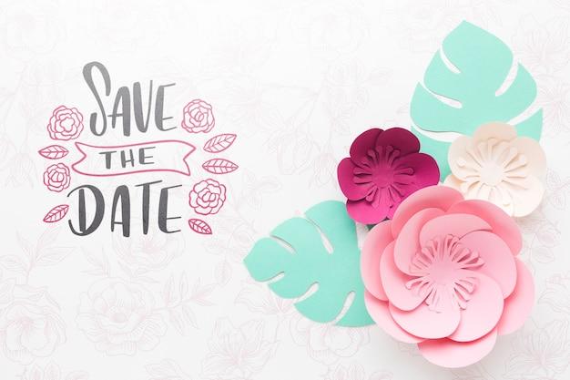 Fleurs en papier avec maquette de fond de mariage