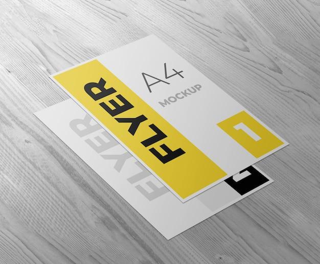 Flyer ou maquette d'affiche sur une table ou un sol en bois