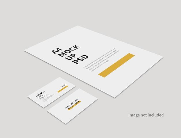 Format a4 réaliste et maquette minimale de carte de visite isolée