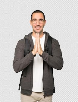 Geste de prière étudiant concerné
