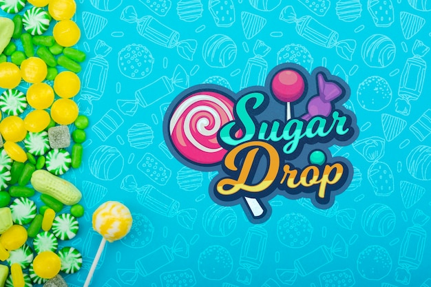 Goutte de sucre avec bâton de sucette et vert avec cadre de bonbons jaunes