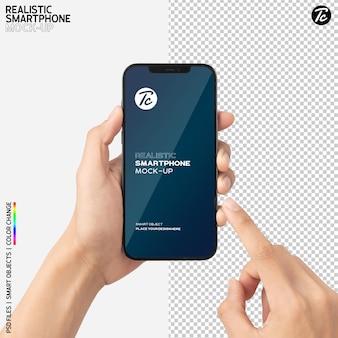 Gros plan main tenant et à l'aide de la maquette du smartphone