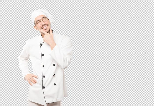 Heureux jeune chef faisant un geste de doute