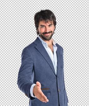 Homme d'affaires faisant une affaire sur fond blanc