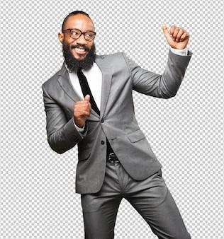 Homme d'affaires noir dansant