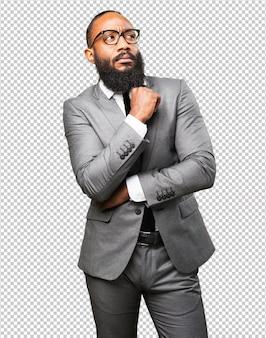 Homme d'affaires noir pensant