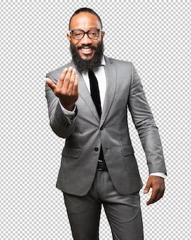 Homme d'affaires noir viens ici geste