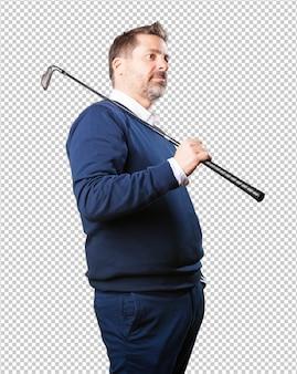 Homme d'âge mûr avec un club de golf