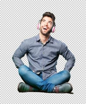 Homme assis sur le sol en pensant