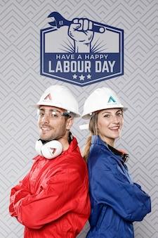 Homme femme, à, chapeau construction, fête du travail