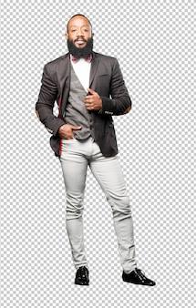 Homme noir élégant complet du corps isolé