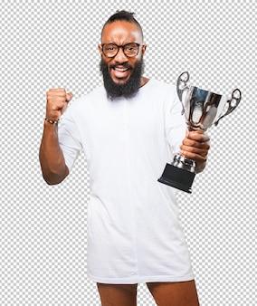 Homme noir tenant un trophée