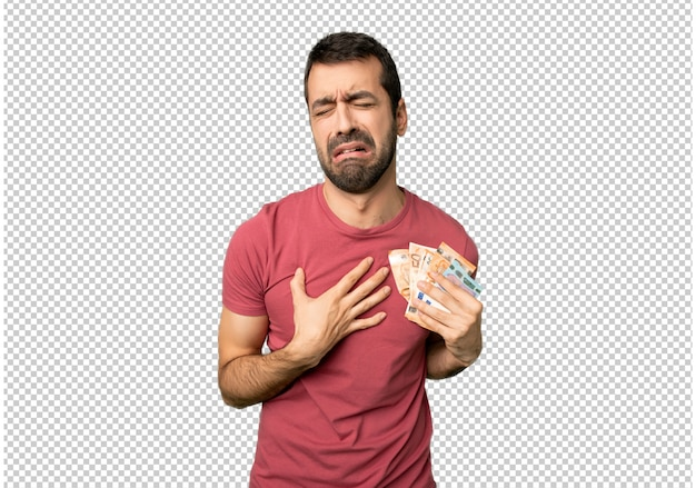 Homme prenant beaucoup d'argent ayant mal au coeur