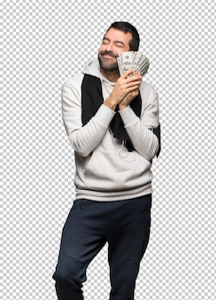 Homme de sport prenant beaucoup d'argent