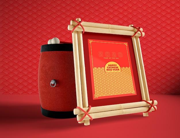 Illustration du nouvel an chinois avec maquette de tambour et cadre