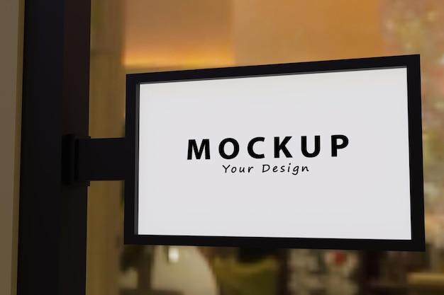 Inscrivez-vous à l'extérieur d'une maquette de logo de boutique