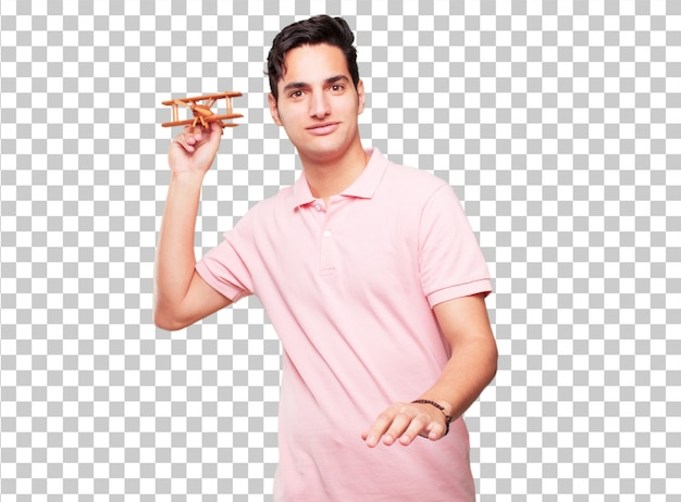 Jeune bel homme bronzé avec un avion en bois