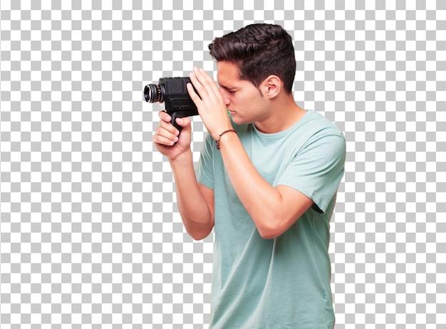 Jeune bel homme bronzé avec une caméra de cinéma vintage